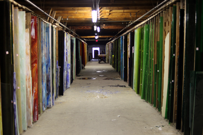There were rows and rows of sheet glass stored.