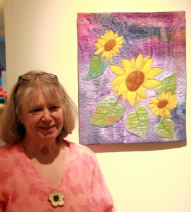 Joan Webb at opening night with her quilt